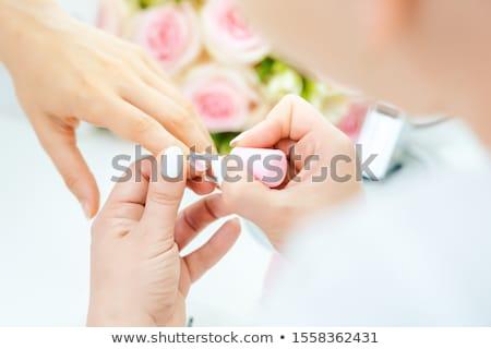 Experienced nail technician applying nail color Stock photo © Kzenon