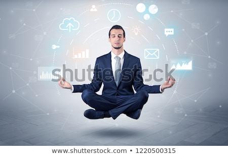 Businessman levitates with data circulation concept Stock photo © ra2studio