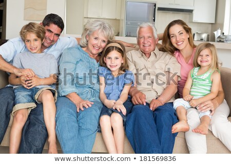 Portrait of smiling multigeneration family spending leisure time Stock photo © Lopolo