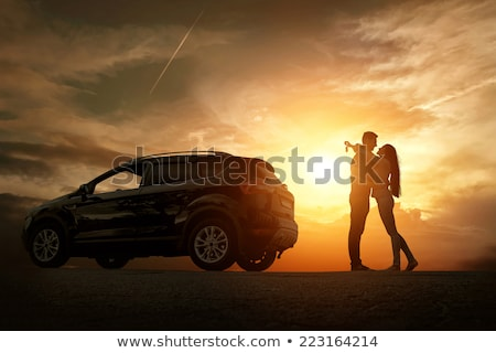 Stock photo: Loving couple outdoors at beach near car.