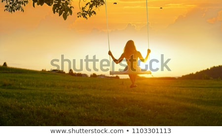 People silhouettes on summer sunset meadow Stock photo © Lopolo