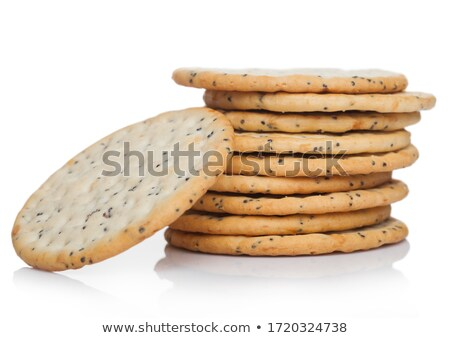 Stack of round organic crispy wheat and five grain salty crackers with seeds on white.  Stock photo © DenisMArt