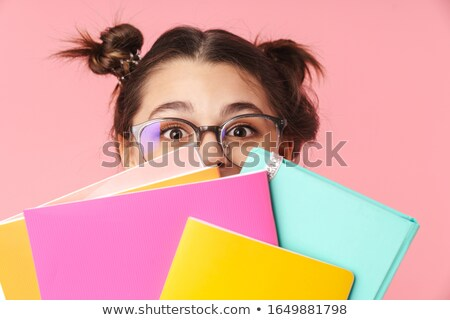 Stock photo: Photo amusing nice girl covering her face with exercise book