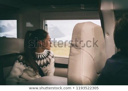 RV camper van travel Asian girl sitting in back of motorhome car on Iceland road trip. Europe vacati Stock photo © Maridav