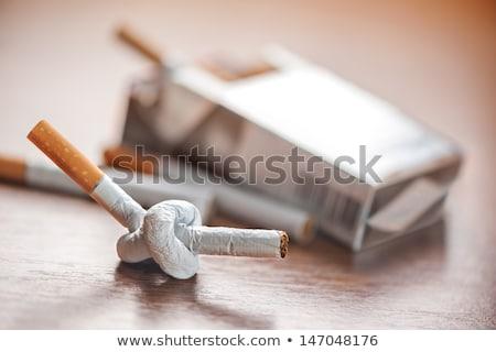 Foto stock: Cigarro · nó · isolado · branco · fumador · alto