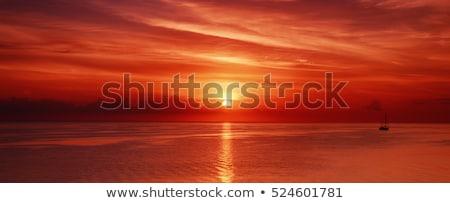 Vermelho pôr do sol belo fino nuvens Malásia Foto stock © ldambies