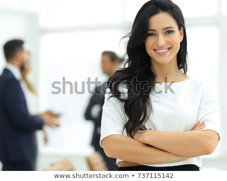 Portrait of a beautiful young businesswoman working. stock photo © HASLOO