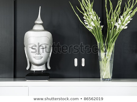 contemporary interior design detail with buddha image and flower Stock photo © travelphotography
