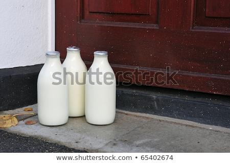 Mleka domu drzwi stanie srebrny butelek Zdjęcia stock © latent