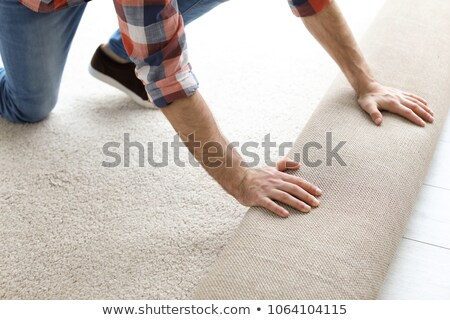 handyman laying fitted carpet Stock photo © photography33