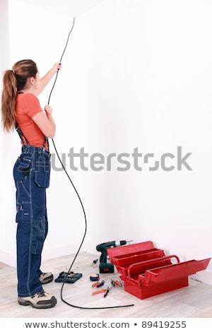 kadın · elektrikçi · kablo · duvar · inşaat - stok fotoğraf © photography33