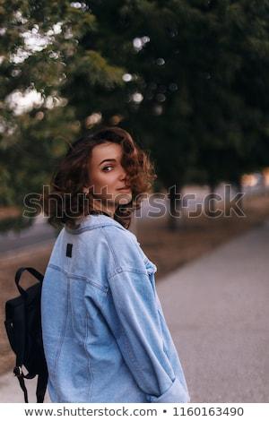 mooie · gelukkig · vrouw · jeans · rond - stockfoto © Rob_Stark