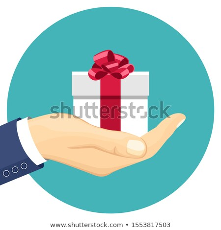 Businessman with a wrapped gift Stock photo © photography33
