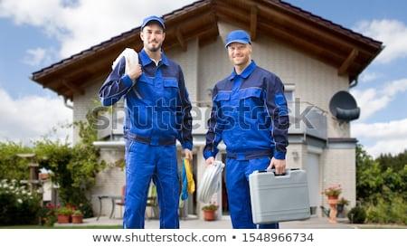 Dwa złota rączka działalności domu ściany pracy Zdjęcia stock © photography33