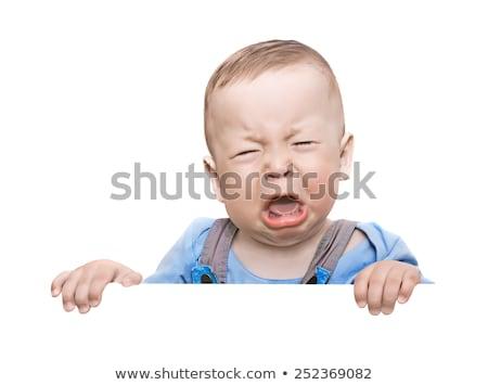 Man grimacing, white background Stock photo © photography33