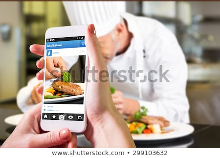 Screen of smartphone in focus. Man holding phone in front Stock photo © adamr