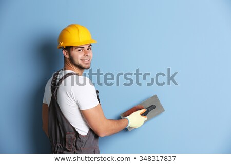 Young worker holding a sander Stock photo © photography33