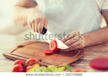closeup of hands cutting tomatoes Stock photo © Rob_Stark
