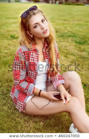 attractive young brunette student outdoors stock photo © lithian