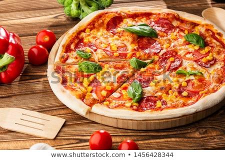 Pepperoni pizza mais bianco consegna torta Foto d'archivio © ozaiachin