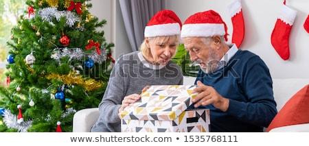 Senior Natale stocking eccitato donna apertura Foto d'archivio © lisafx