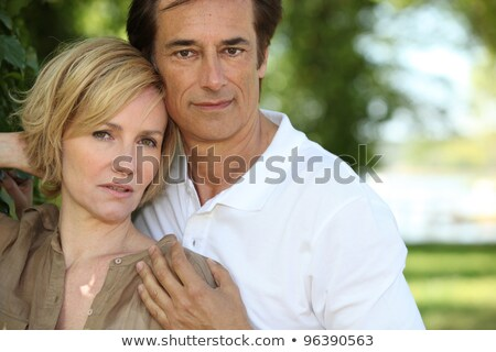 sultry couple stood by tree in park stock photo © photography33