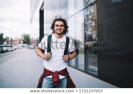 Half length portrait of stylish casual young guy Stock photo © stockyimages