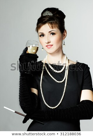 Woman in a little black dress with a glass of champagne Stock photo © photography33