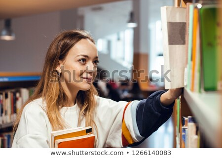 young female student with laptop surrounded by books Stock photo © photography33