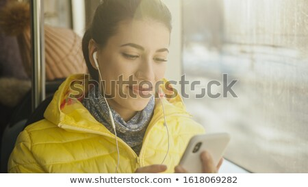 Young woman on cellphone on the tram Stock photo © photography33