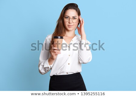 Portrait of a cute businesswoman holding a takeaway tea against a white coffee Stock photo © wavebreak_media