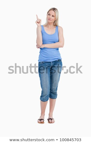 Blonde woman raising her finger while crossing arms against a white background Stock photo © wavebreak_media