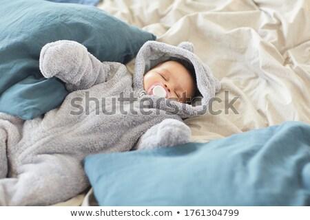 Baby sleeping while sucking a pacifier indoors stock photo © wavebreak_media