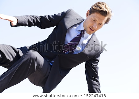 Businessman jumping over something stock photo © Rugdal