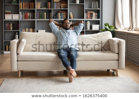 casual man holds hand behind head stock photo © feedough