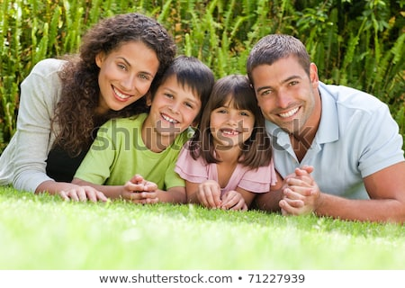 Happy family lying as a circle Stock photo © get4net