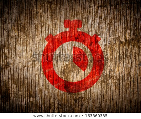 Red Stopwatch Icon Painted by Stencil on Wood. Stock photo © tashatuvango