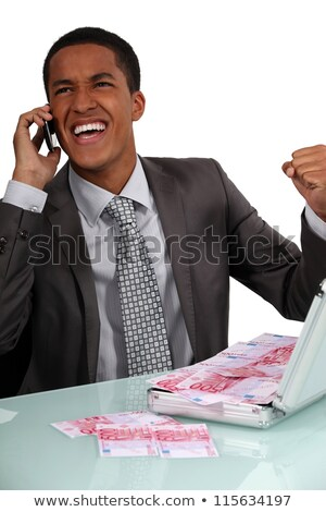 Ecstatic businessman with a briefcase full of money Stock photo © photography33