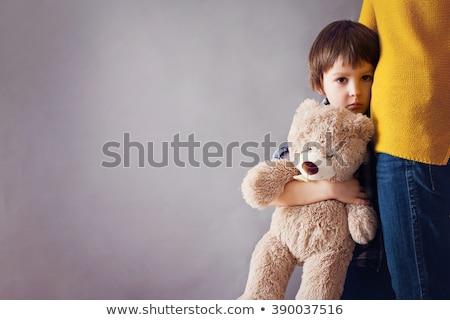 portrait of cute sad boy stock photo © meinzahn