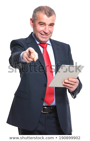 smiling old business man pointing his finger stock photo © feedough