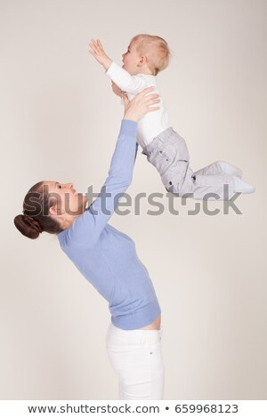 Mother is smiling when holding up her baby stock photo © DNF-Style