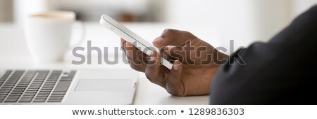 African male using is cell phone Stock photo © stockyimages