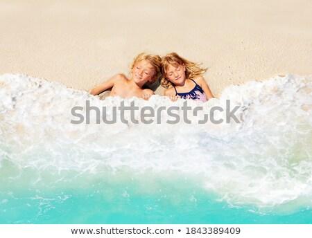 Fiú álmodozás tengerpart természet tenger jókedv Stock fotó © monkey_business