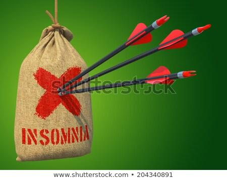 Insomnia - Arrows Hit in Red Mark Target. Stock photo © tashatuvango