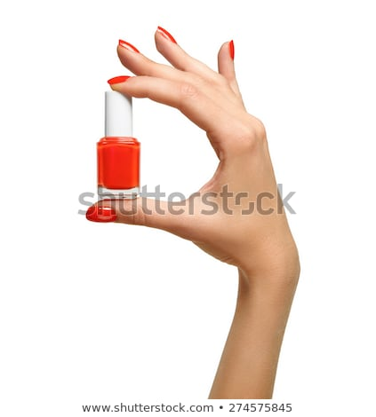 Woman's hand with a bottle of red nail polish Stock photo © Anettphoto