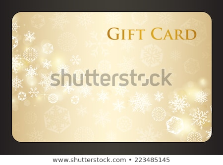 Exclusive cream christmas gift card with stream of golden snowflakes Stock photo © liliwhite