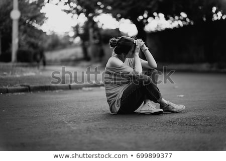 Stock photo: Sitting sad woman, black and white picture