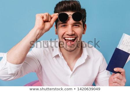 Elegant business man taking off his glasses  Stock photo © feedough
