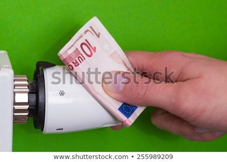 Radiator thermostaat bankbiljet hand groene vrouw Stockfoto © bubutu