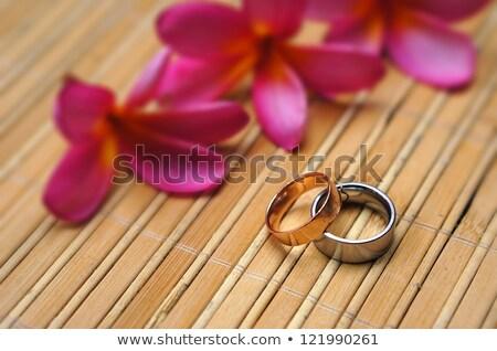 two wedding rings on bamboo mat stock photo © sfinks